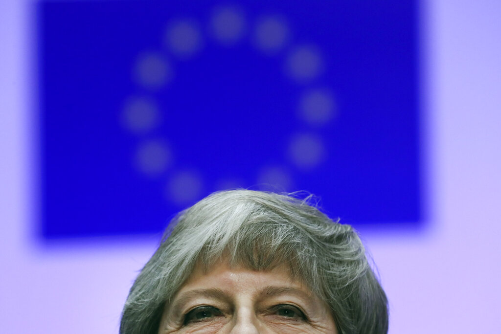UK leader May under mounting pressure to delay Brexit