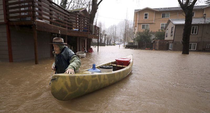 Storm water floods California towns only reachable by boat