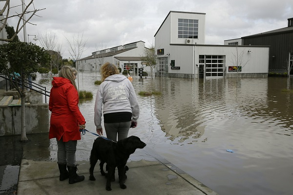 2,000 buildings flooded in California as storms slam West