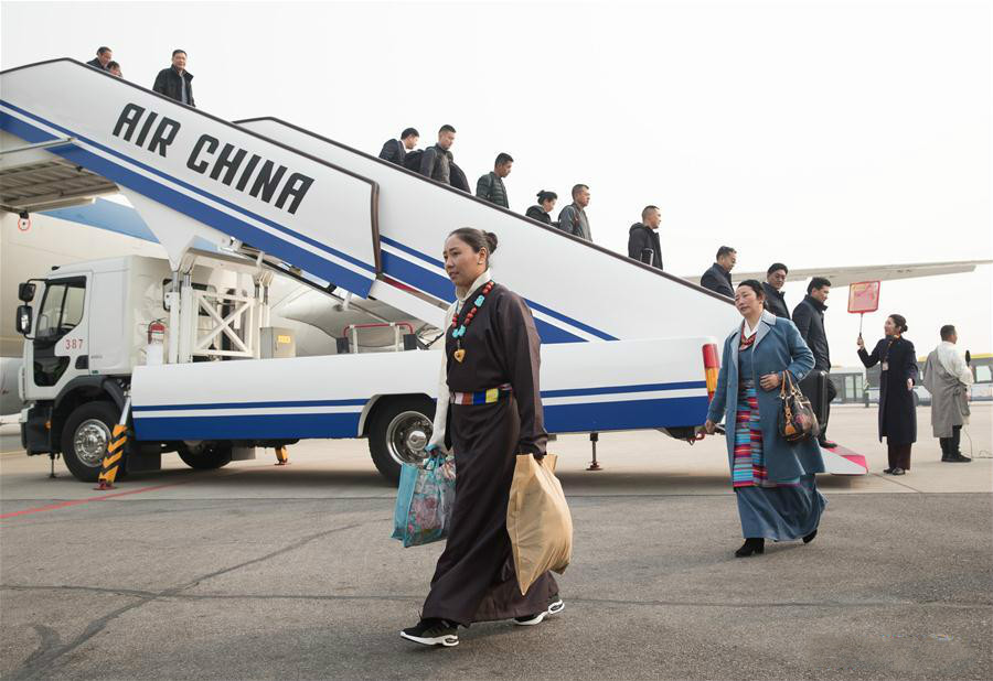 Deputies to 13th NPC from China's Tibet arrive in Beijing