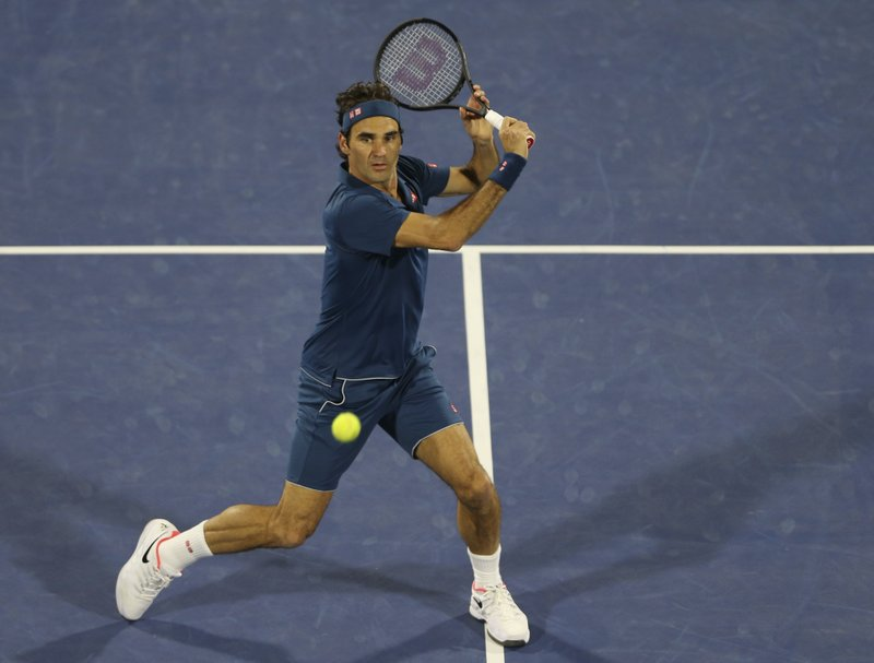 Federer wins Dubai final to join Connors in century club