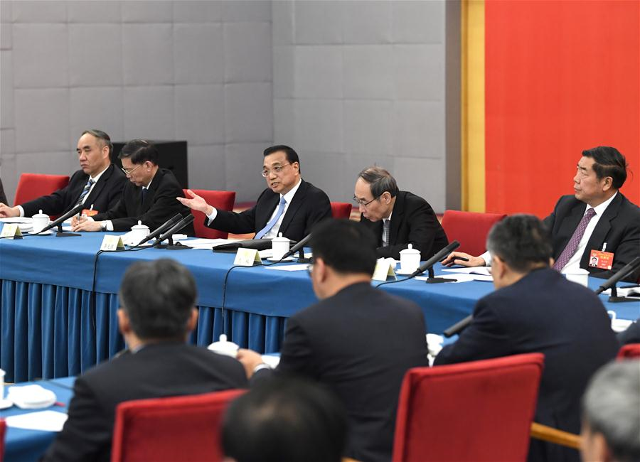 Chinese leaders join panel discussions with political advisors
