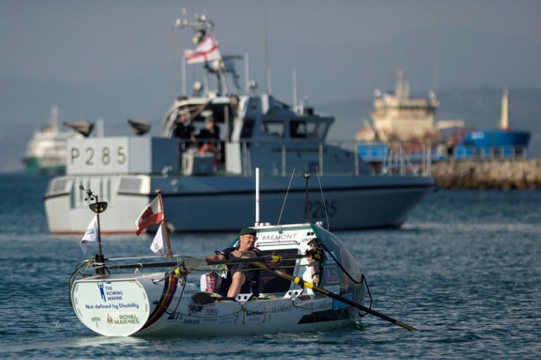 Disabled former British marine 'smashes solo Atlantic rowing record'