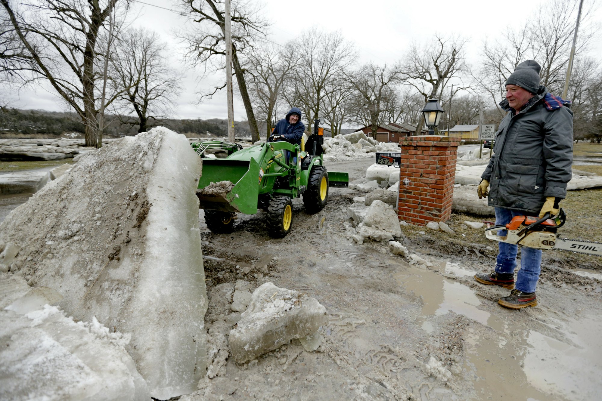 Heavy rain atop frozen ground causes flooding in US Midwest