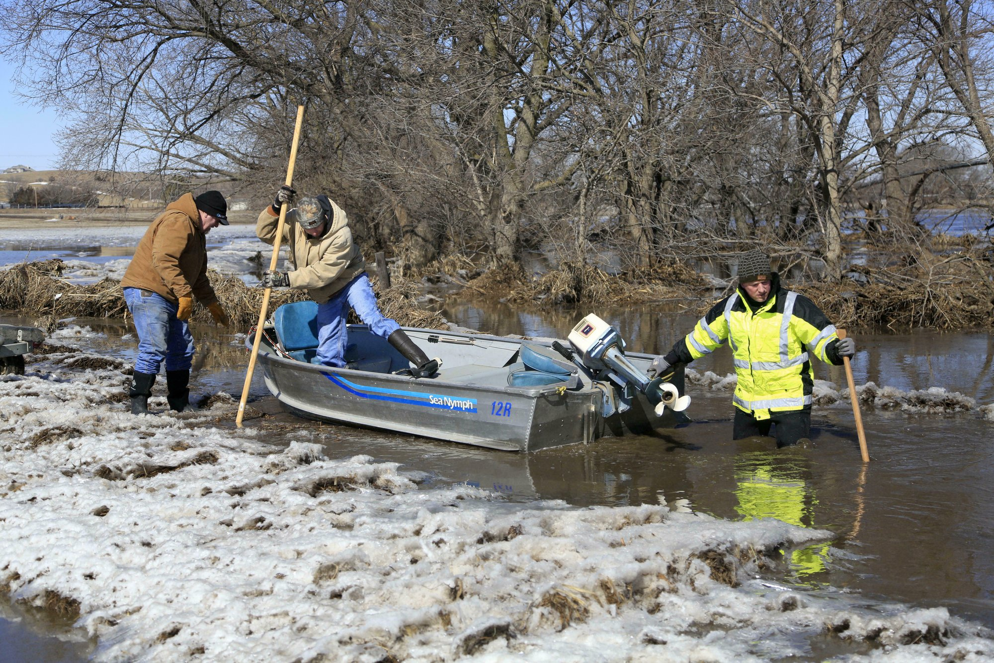 Rescues, evacuations as floodwaters breach levees in US Midwest