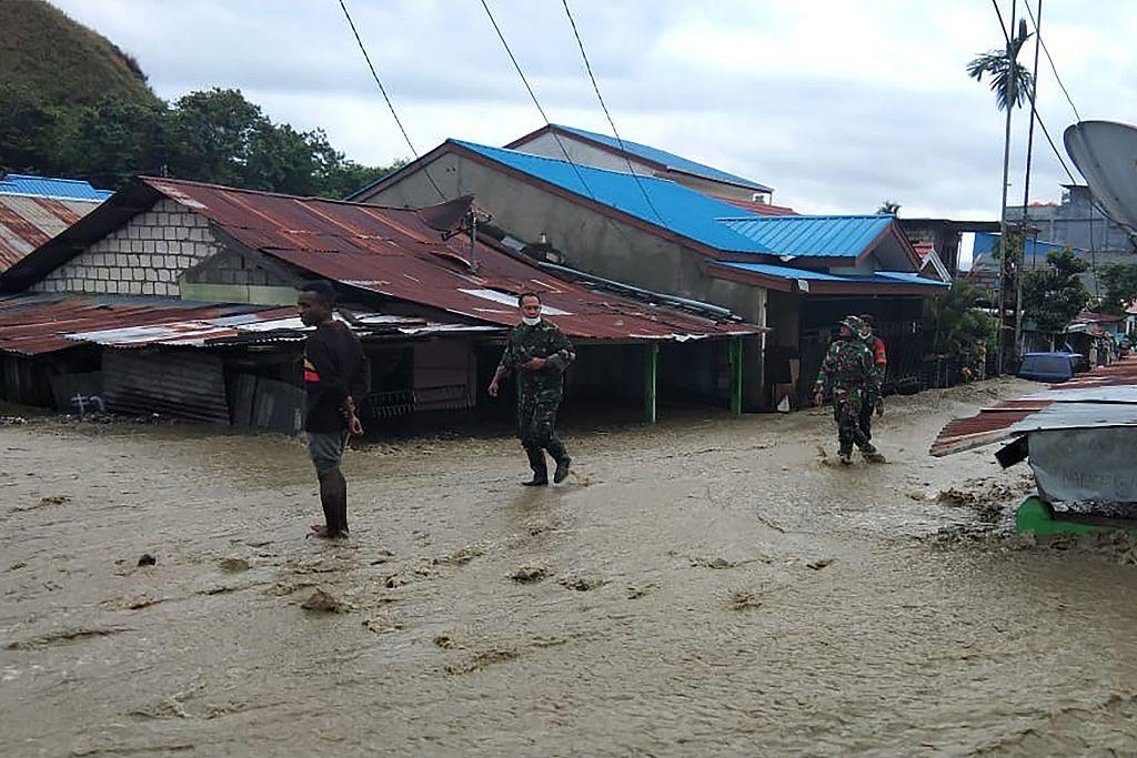 Flash floods, earthquake in Indonesia kill over 80