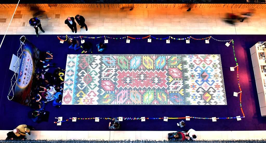 Sarajevo-made bottle cap carpet at International Recycling Day
