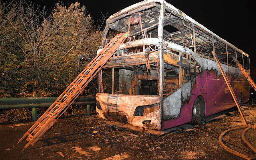 26 dead, 28 injured in central China coach fire