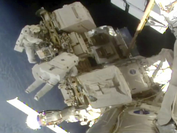 Spacewalking astronauts install better station batteries
