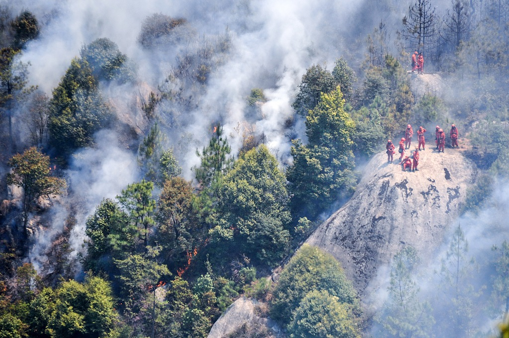 Forest fire contained in southwest China's Sichuan