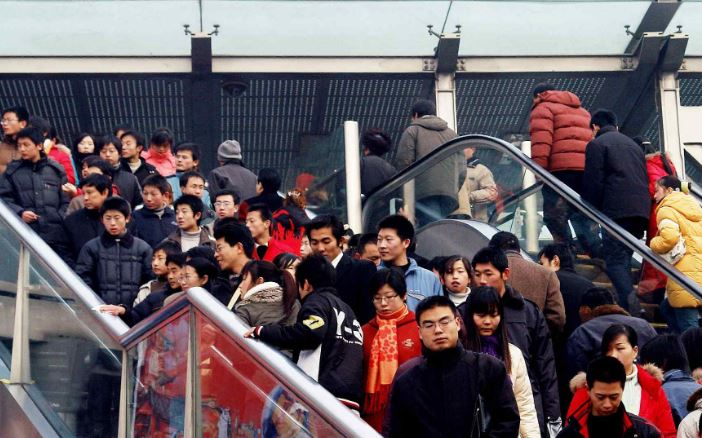 China to ease permanent residency requirements in large cities