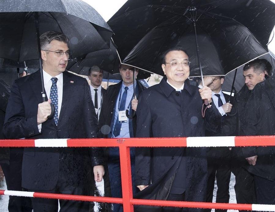 Chinese, Croatian PMs visit Peljesac Bridge project amid rain