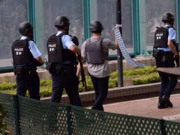 Hong Kong police hunting for gunman in suspected shooting
