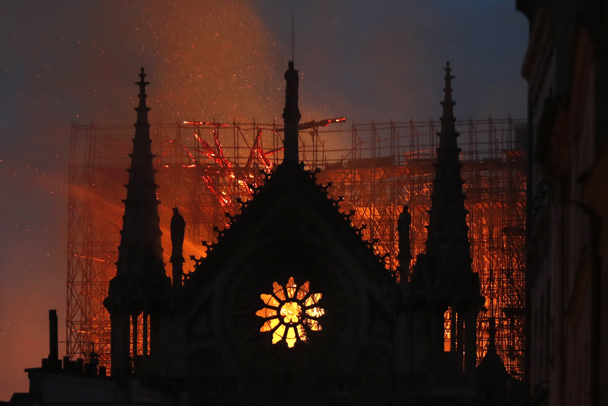 Iconic Notre Dame spire collapses during fire