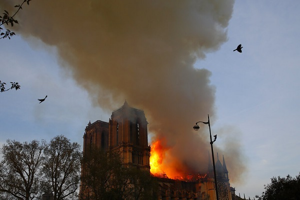 International sorrow as fire ravages Notre-Dame in Paris