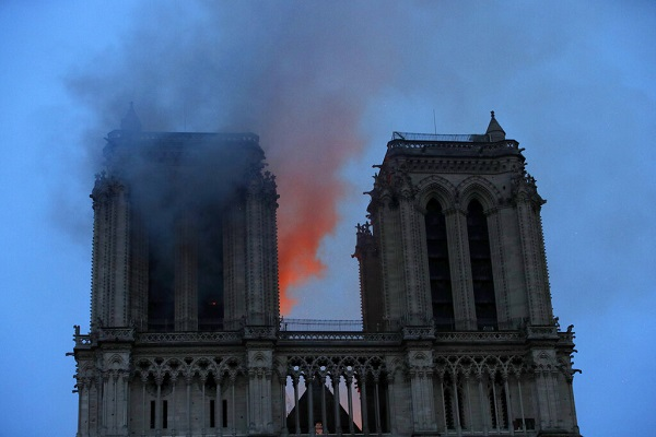The Latest: French billionaires act for Notre Dame