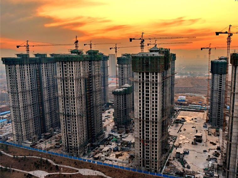 China's home prices edge up in March
