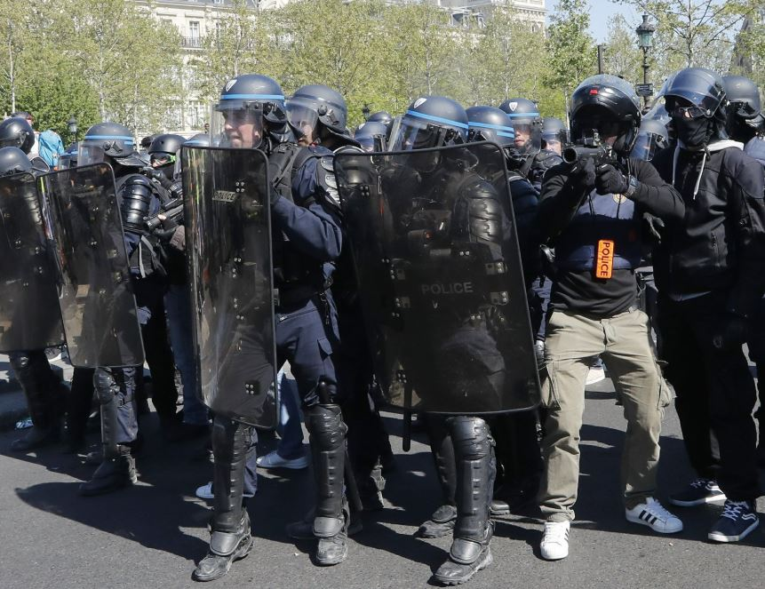 Masked protesters clash with police in Paris