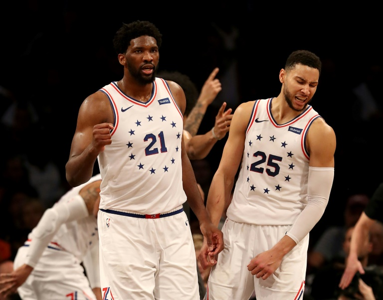 Embiid sparks 76ers to NBA playoff win after two ejected