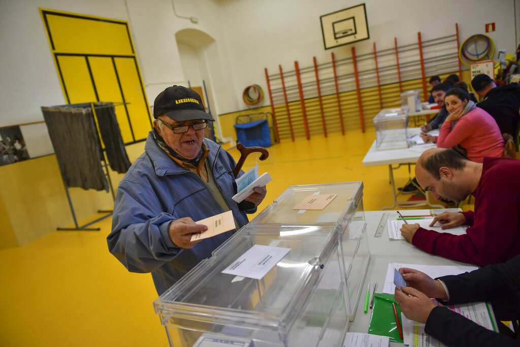Deeply divided, Spaniards vote with eye on far-right's rise