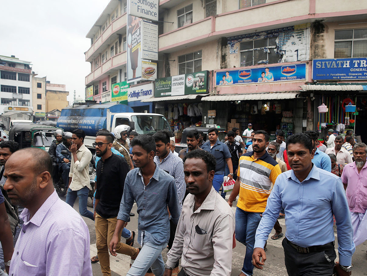 People-cross-a-street-in-central-Colombo_16a680e6d8b_large.jpg