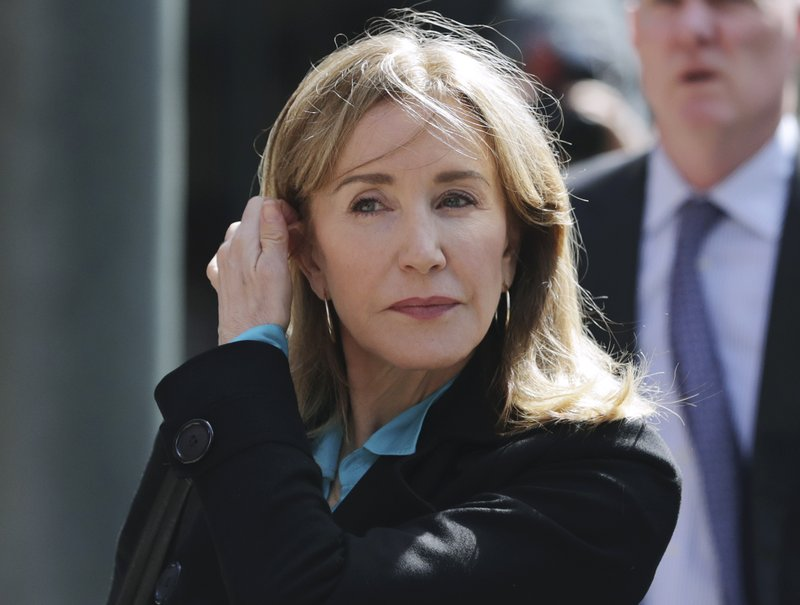 Felicity Huffman to plead guilty in admissions scam May 13