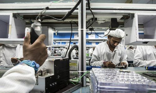 India's factory output growth slumps to slowest in 8 months