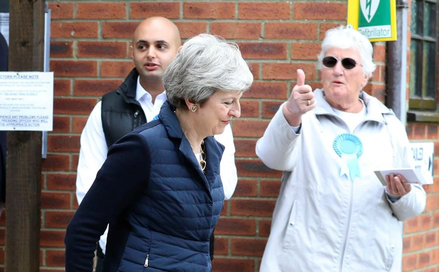 British PM's Conservatives suffer heavy losses in local elections