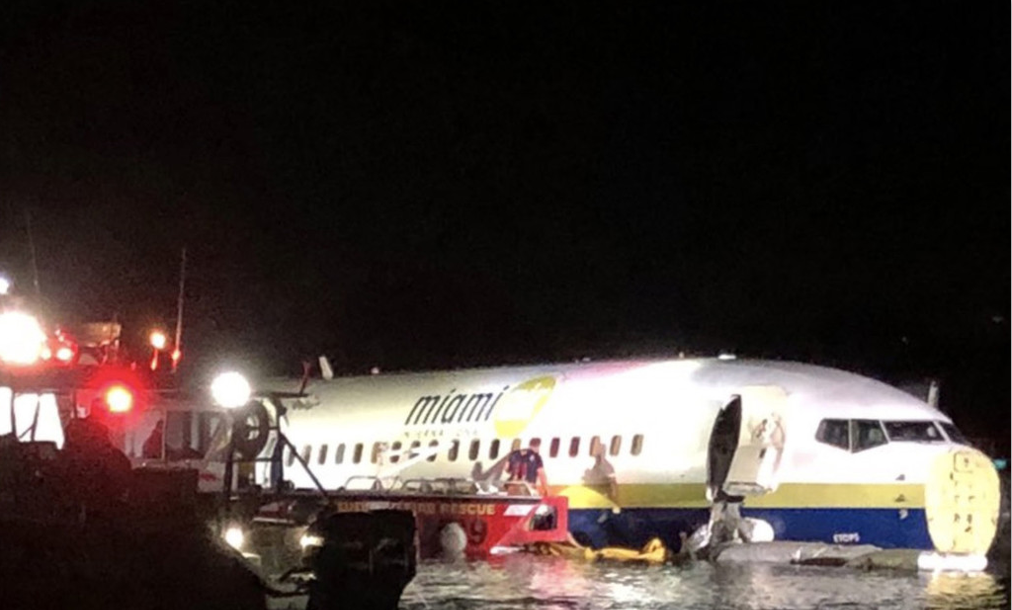 US commercial plane slides into river with all lives 'accounted for'