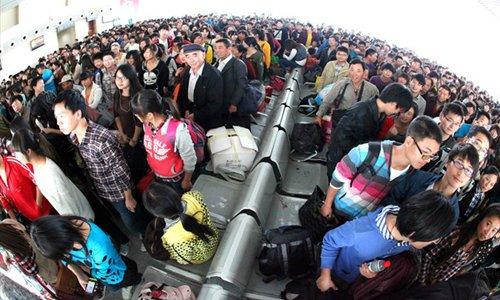 China's national rail operator apologizes for train overloads at peak season