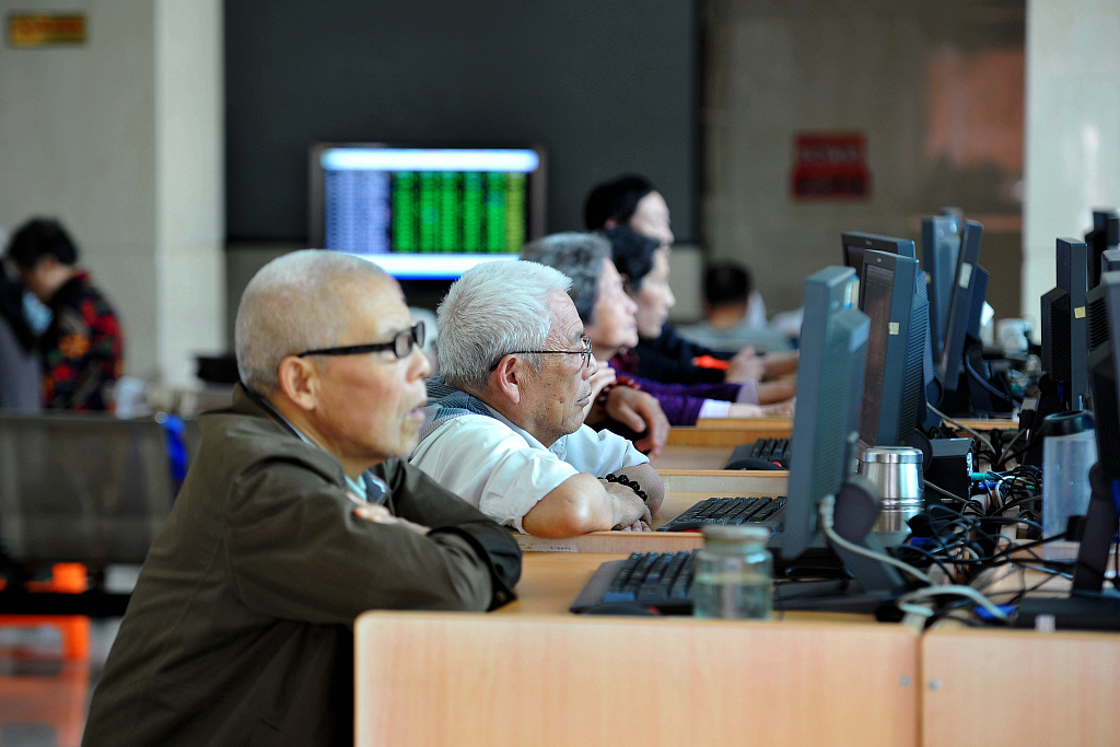 Chinese shares close higher at midday Friday