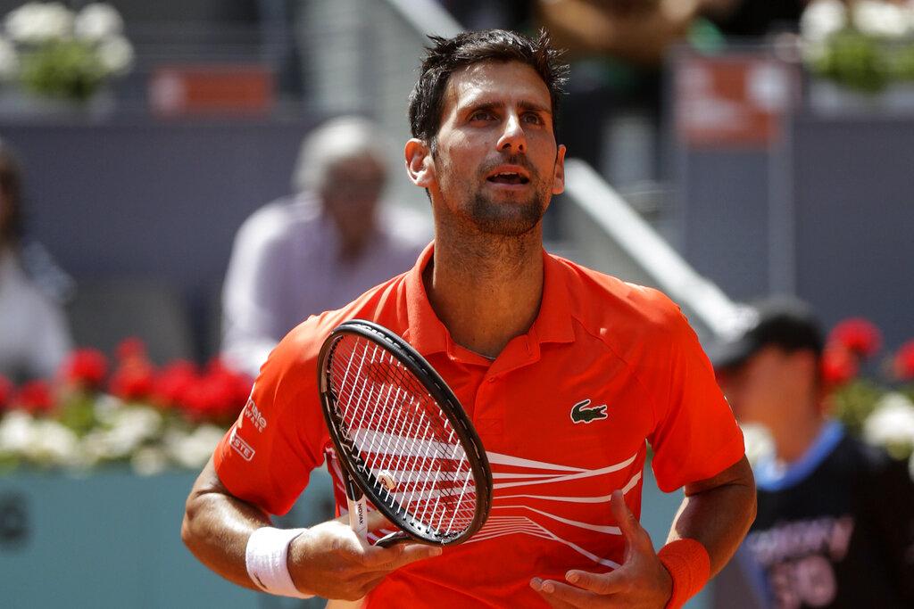 Cilic withdraws, Djokovic reaches Madrid Open semifinals