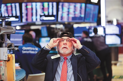 Dow drops more than 700 points amid trade tensions