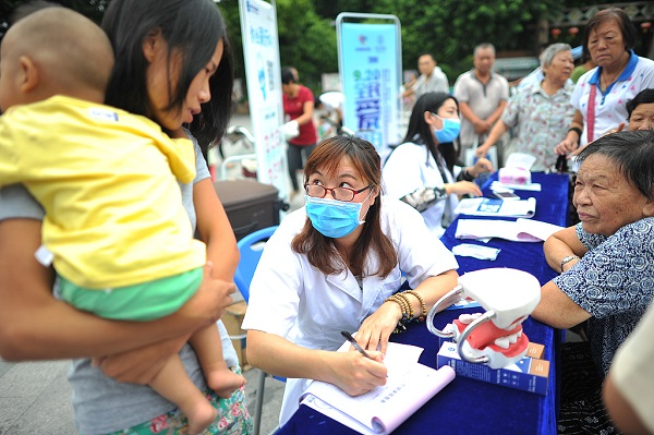 Chinese authorities expand health aid program for impoverished people