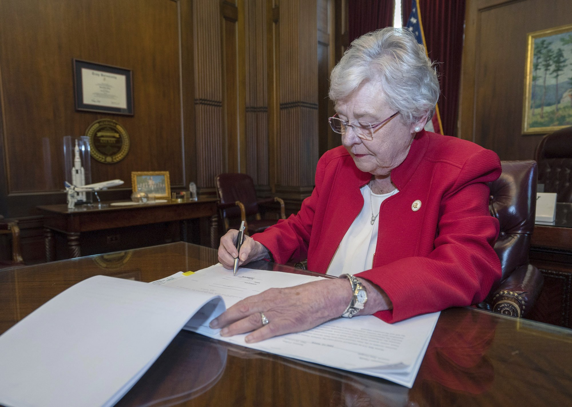 Alabama governor invokes God in banning nearly all abortions