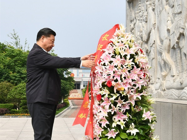 Xi presents flower basket to memorial for the Long March starting point of the Central Red Army