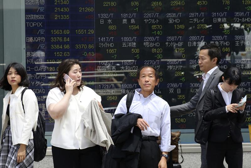 Tokyo stocks open lower on Wall Street's weak overnight lead