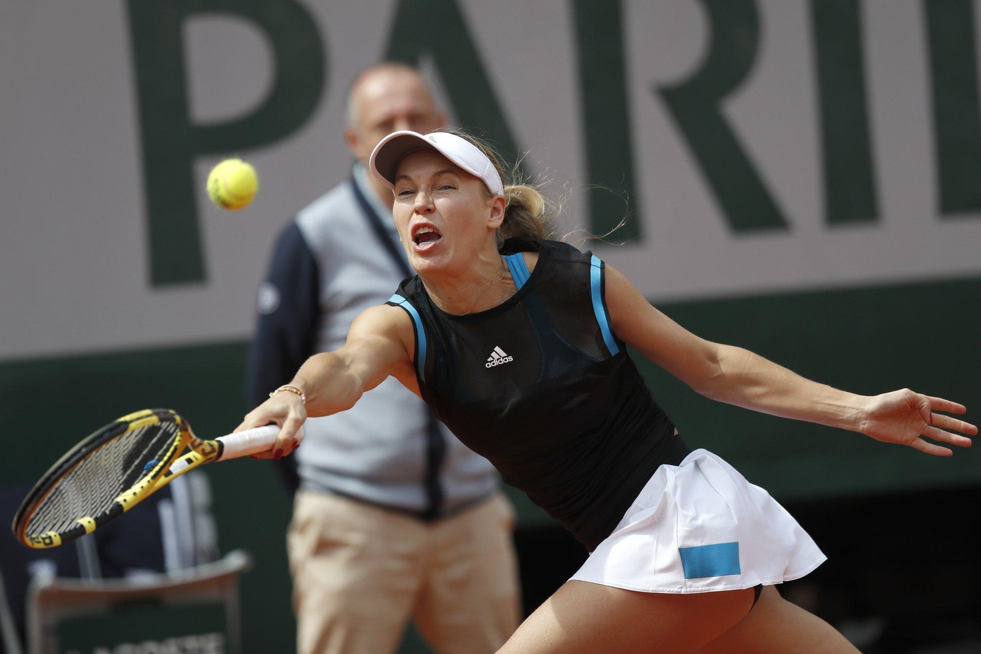 Wozniacki exits French Open; Nadal, Djokovic win easily
