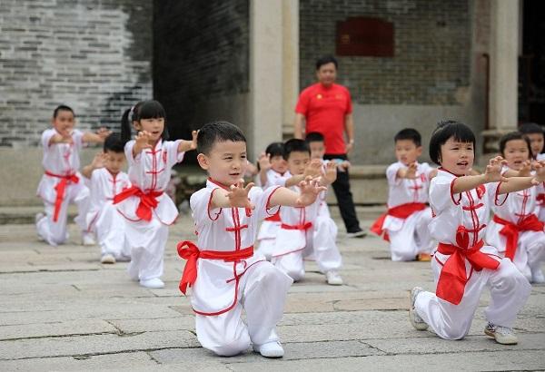In photos: Children practice martial arts in Guangdong