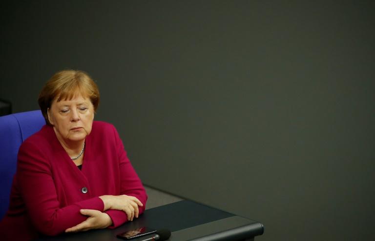 Crisis talks as Merkel's coalition suffers new blow