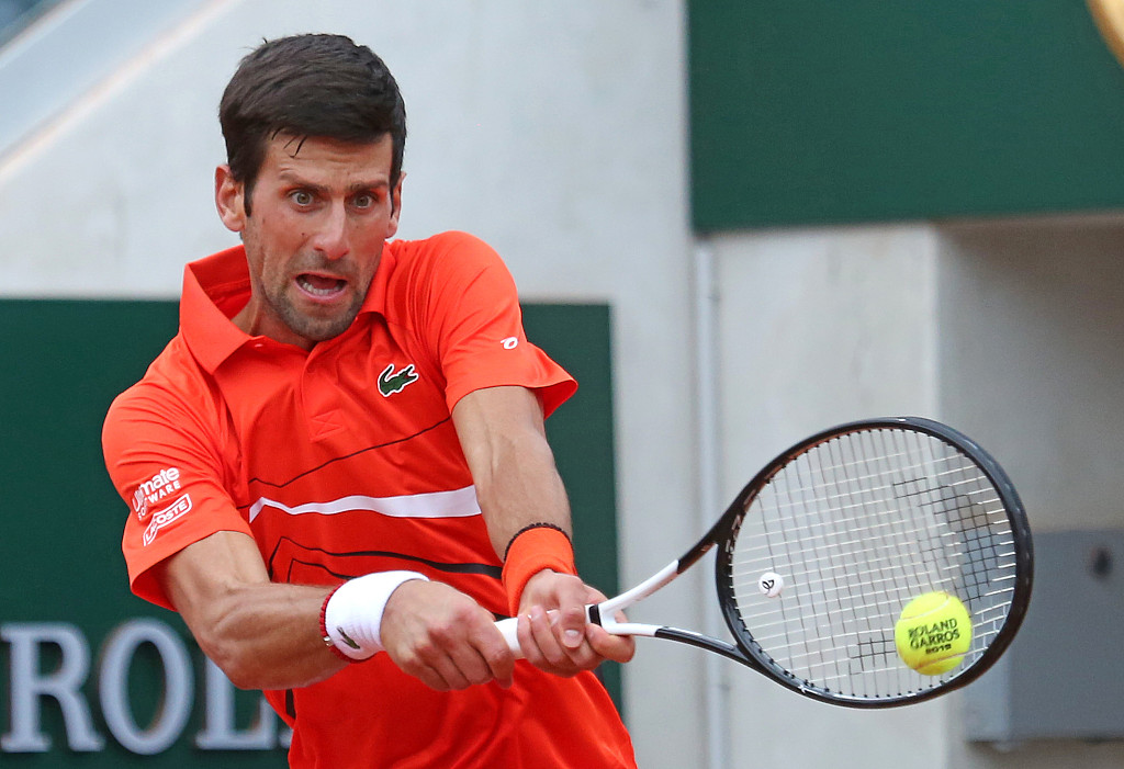 Djokovic reaches quarters for record 10th straight year, Halep marches on