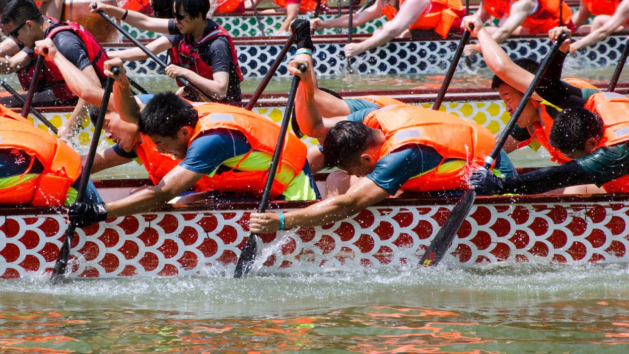 People across China celebrate with boat races, rice dumplings