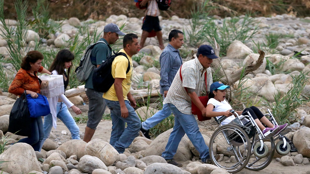 Venezuela to partially reopen border with Colombia