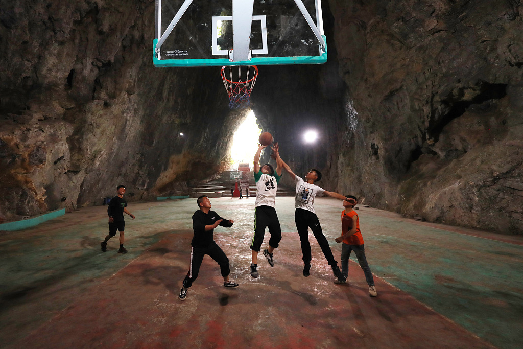 Basketball court inside a karst cave popular in SW China