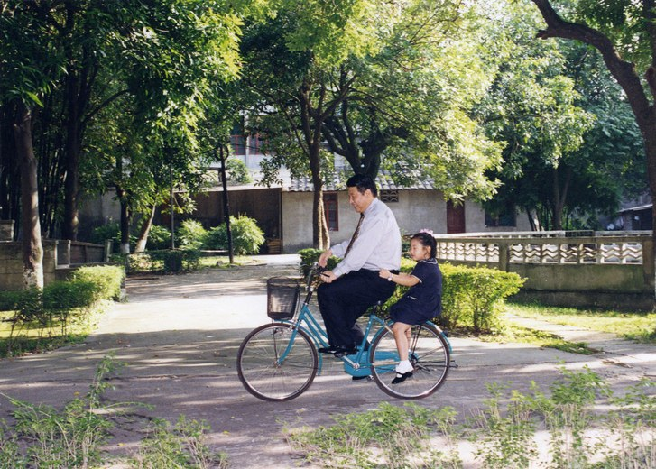 Xi Jinping: Loving father and son