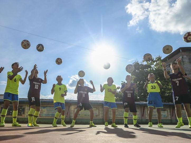 Pic story: girl football team at nine-year school of Hualan Town, S China's Guangdong