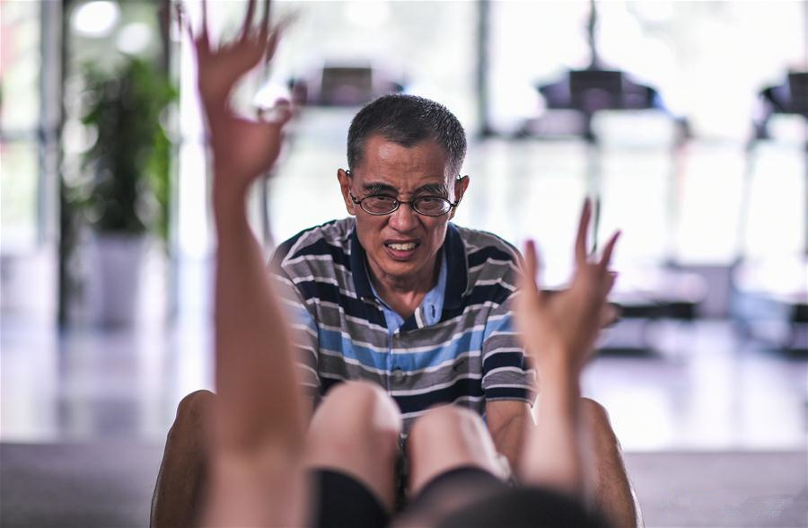 Pic story: a father, also a private trainer of son with cerebral palsy