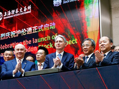 Stock link opens, joins two global capital hubs