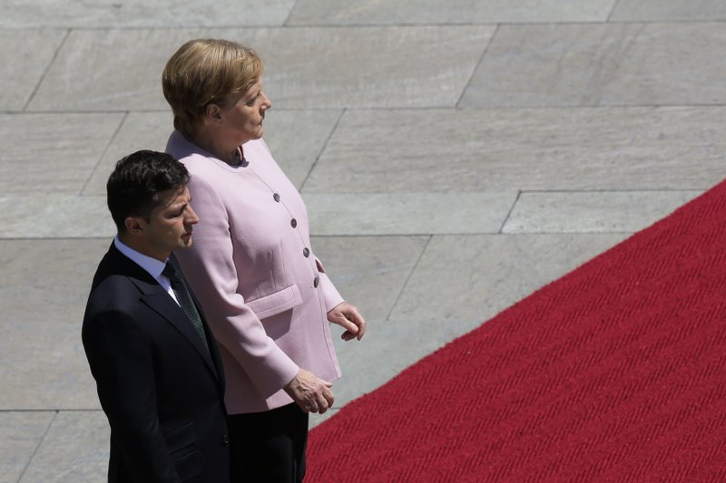 Germany's Merkel says she's OK after shaking at ceremony