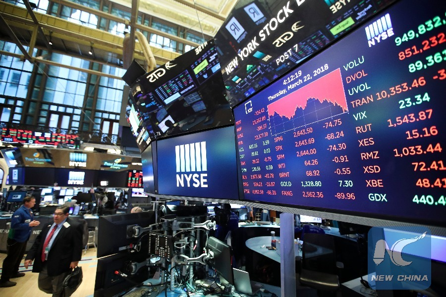 US stocks close higher as Fed holds interest rate steady